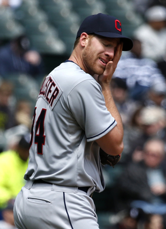 Photo - Cleveland Indians starting pitcher Zach McAllister wipes the sweat from his face during the third inning of a baseball game against the Chicago White Sox Wednesday, April 24, 2013, in Chicago. (AP Photo/Charles Rex Arbogast)