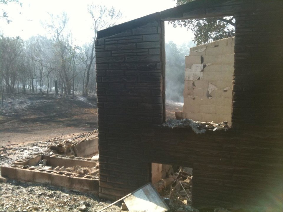 Photo - Burned house at 5900 NE 66th. Photo by Jim Beckel, The Oklahoman.