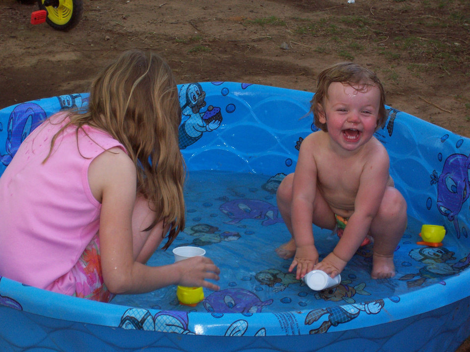 Page Dowis (age: 2)with cousin, Demi Dowis, spend the hot Easter afternoon in the pool kicking off the early summer weather.<br/><b>Community Photo By:</b> Cheryl Dowis<br/><b>Submitted By:</b> Cheryl, Bethany