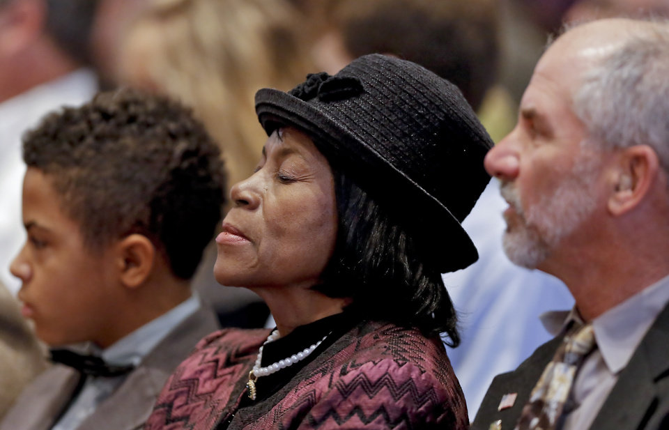 Delphia Hawkins takes a moment to close her eyes while the names of the bombing victims are read during the 18th Anniversary Remembrance Ceremony of the Oklahoma City bombing on Friday, April 19, 2013, in Oklahoma City, Okla. Photo by Chris Landsberger, The Oklahoman