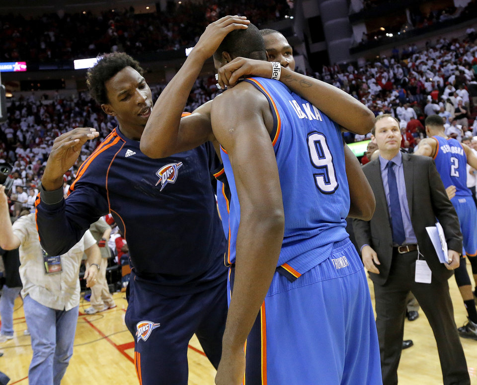 Photo - Oklahoma City's Kevin Durant (35) and Hasheem Thabeet (34) celebrate with Serge Ibaka (9) after Game 3 in the first round of the NBA playoffs between the Oklahoma City Thunder and the Houston Rockets at the Toyota Center in Houston, Texas, Sat., April 27, 2013. Oklahoma City won 104-101. Photo by Bryan Terry, The Oklahoman