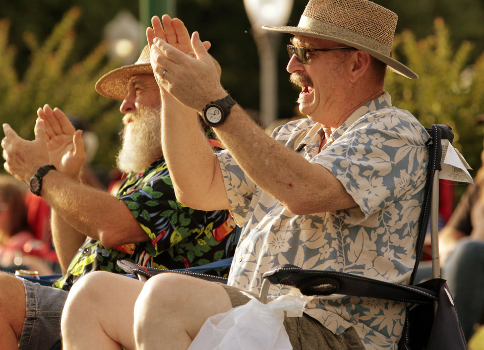 Dave Wildes, right, and Larry Mudd applaud a performance at Brookhaven Village at last year's Jazz in June Festival. OKLAHOMAN ARCHIVES <strong>STEVE SISNEY</strong>