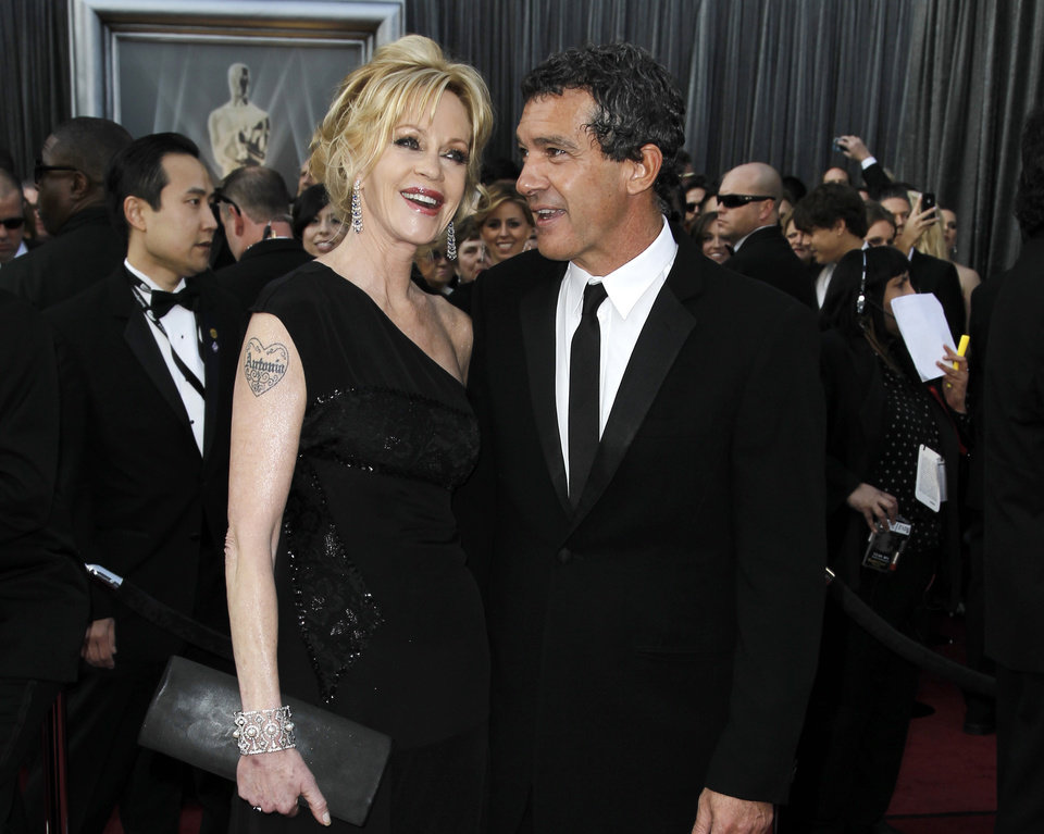 Photo - FILE - This Feb. 26, 2012 file photo shows actress Melanie Griffith sporting a tattoo, left, and her husband Antonio Banderas at 84th Academy Awards in the Hollywood section of Los Angeles. Griffith filed for divorce from Banderas on Friday June 6, 2014 in Los Angeles, citing irreconcilable differences as the reason for the end of their 18-year marriage.  (AP Photo/Matt Sayles, File)