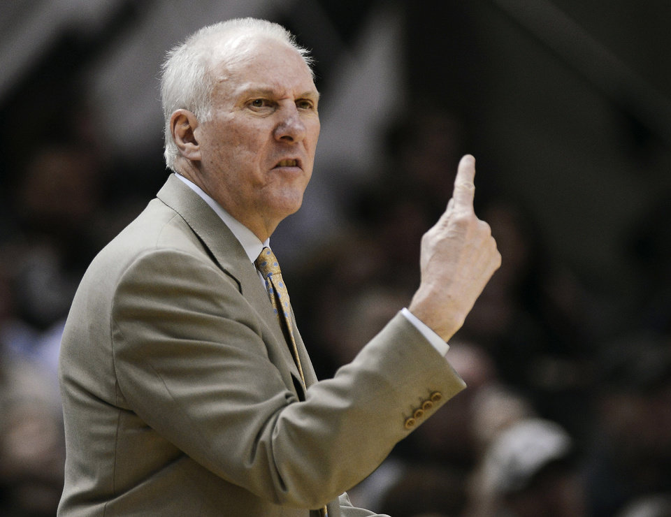 Photo - San Antonio Spurs hcoach Gregg Popovich yells to his players during the second half of an NBA basketball game against the Sacramento Kings on Saturday, Feb. 1, 2014, in San Antonio. San Antonio won 95-93. (AP Photo/Darren Abate)