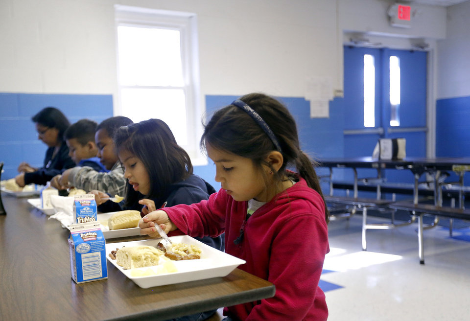Photo - Kinley Miller eats lunch at Ryal Public School, Wednesday, Feb. 13, 2013. Photo by Sarah Phipps, The Oklahoman