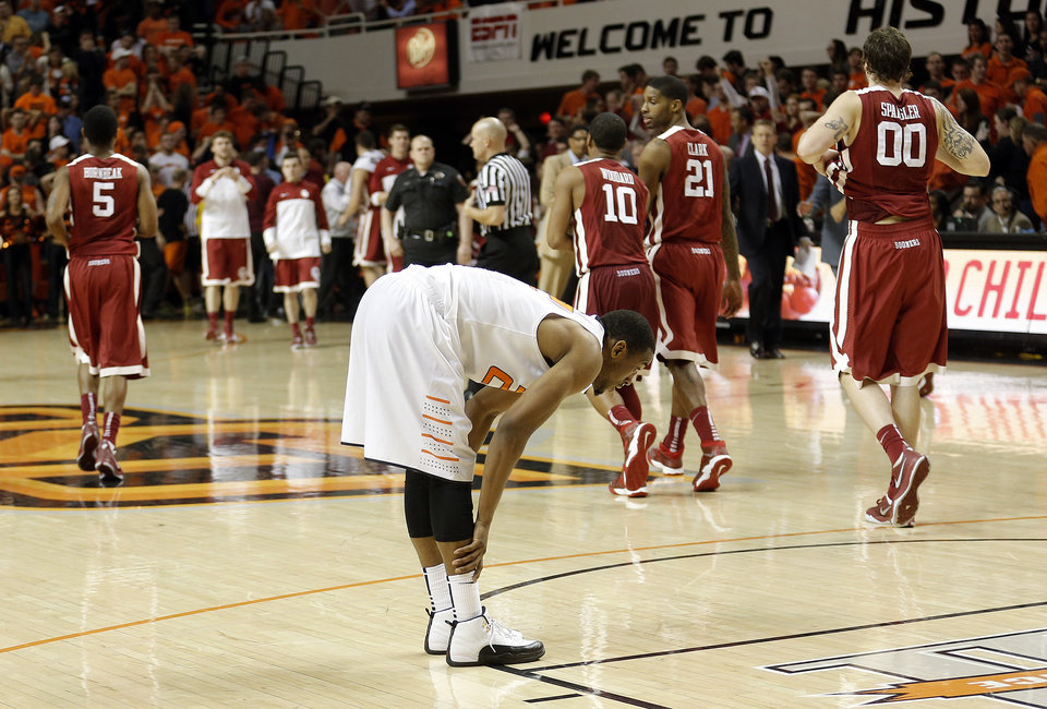 Oklahoma State's Markel Brown (22) reacts after loosing to Oklahoma during the men's Bedlam college game between Oklahoma and Oklahoma State at Gallagher-Iba Arena in Stillwater, Okla., Saturday, Feb. 15, 2014. Photo by Sarah Phipps, The Oklahoman