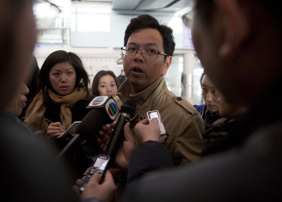 Photo - A Malaysian man who says he has relatives on board the missing Malaysian Airlines plane, talks to journalists at Beijing's International Airport Beijing, China, Saturday, March 8, 2014. A Malaysia Airlines Boeing 777-200 carrying 239 people lost contact with air traffic control early Saturday morning on a flight from Kuala Lumpur to Beijing, and international aviation authorities still hadn't located the jetliner several hours later. (AP Photo/Ng Han Guan)