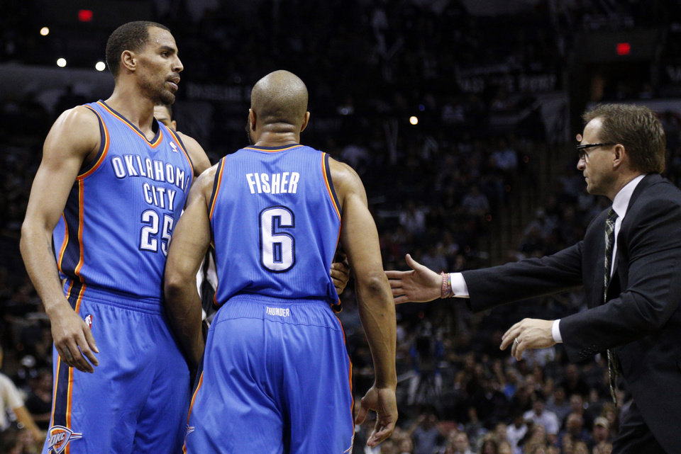 Photo - Oklahoma City's Thabo Sefolosha (25) and head coach Scott Brooks hold Derek Fisher (6) back as he argues with San Antonio's Jeff Ayres (11) during Game 5 of the Western Conference Finals in the NBA playoffs between the Oklahoma City Thunder and the San Antonio Spurs at the AT&T Center in San Antonio, Thursday, May 29, 2014. Photo by Sarah Phipps, The Oklahoman