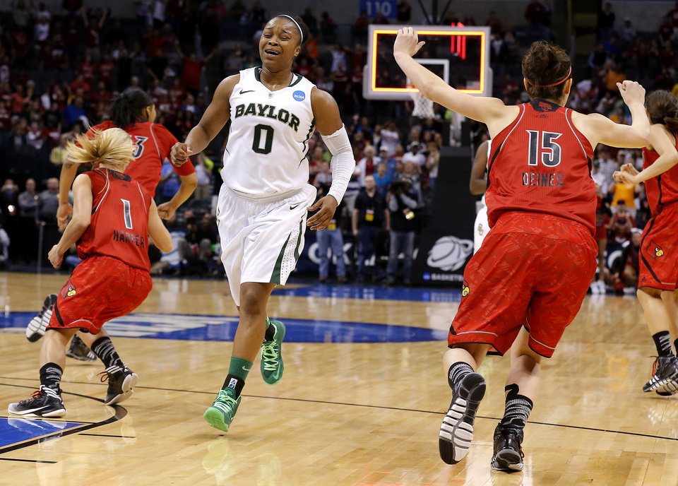 Baylor's Odyssey Sims (0) reacts as Louisville's Shelby Harper (1) and Megan Deines (15) celebrate during college basketball game between Baylor University and the Louisville at the Oklahoma City Regional for the NCAA women's college basketball tournament at Chesapeake Energy Arena in Oklahoma City, Sunday, March 31, 2013. Photo by Sarah Phipps, The Oklahoman