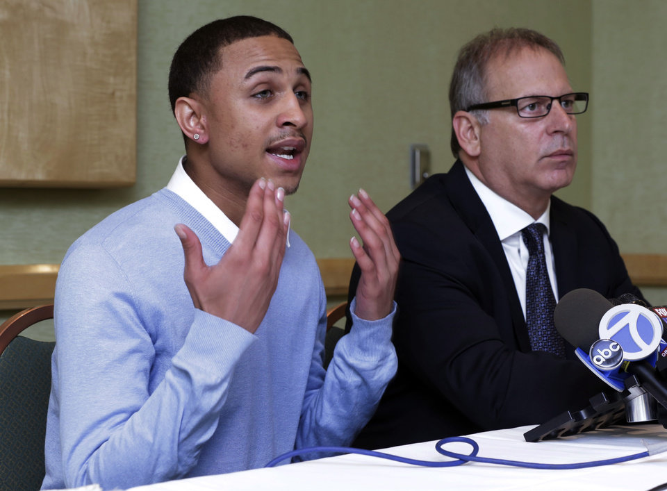 Photo - Sheldon Stephens, left, accompanied by his attorney Jeff Herman, addresses a news conference, in New York, Tuesday, March 19, 2013. Stephens, 24, of Harrisburg, Pa., has filed suit against Kevin Clash, former voice of the