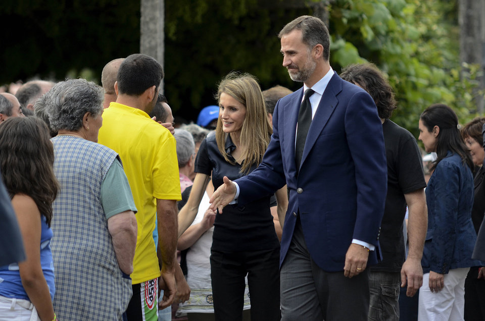"Photo - Spain's Crown Prince Felipe, right and Princess Letizia meet with residents of the village of Angrois, near the train crash site just outside of Santiago de Compostela, Spain, Friday July 26, 2013. The Spanish royals met with the villagers, some who were first on the scene to help pull passengers out of the wreckage. Investigators have taken possession of the ""black boxes"" of the Spain train that hurtled at high-speed along a curve and derailed, killing 80 people, a court official said Friday. (AP Photo/Brais Lorenzo)"