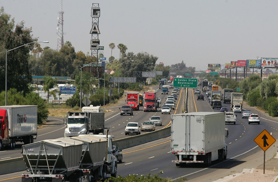 Photo - FILE - In this Aug. 23, 2011 file photo, a stretch of the Calif. State Route 99 corridor in the San Joaquin Valley is shown busy with traffic in Fresno, Calif.  CThe United Nations climate chief is urging people not to look solely to their governments to make tough decisions to slow global warming, and instead to consider their own role in solving the problem. Approaching the half-way point of two-week climate talks in Doha, Christiana Figueres, the head of the U.N.'s climate change secretariat, said Friday, Nov. 30, 2012 that she didn't see