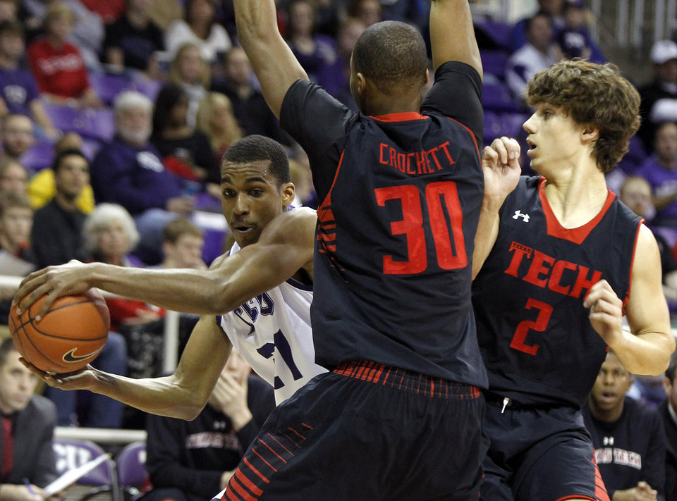TCU's Nate Butler Lind , rear, left, tries to move past Texas Tech's Jaye Crockett (30) and Dusty Hannahs (2) during an NCAA college basketball game Saturday, Jan. 5, 2013, in Fort Worth, Texas. Texas Tech defeated TCU 62-53. (AP Photo/The Fort Worth Star-Telegram, Joyce Marshall) MAGS OUT; (FORT WORTH WEEKLY, 360 WEST); INTERNET OUT