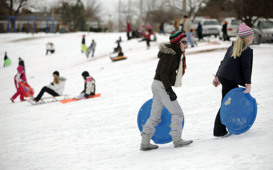 Photo - The slopes were full of sledders at Douglas Park in Oklahoma City, OK, Thursday, Feb. 3, 2011. By Paul Hellstern, The Oklahoman