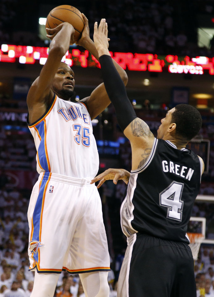 Photo - Oklahoma City's Kevin Durant (35) shoots over San Antonio's Danny Green (4) during Game 6 of the Western Conference Finals in the NBA playoffs between the Oklahoma City Thunder and the San Antonio Spurs at Chesapeake Energy Arena in Oklahoma City, Saturday, May 31, 2014. Photo by Bryan Terry, The Oklahoman
