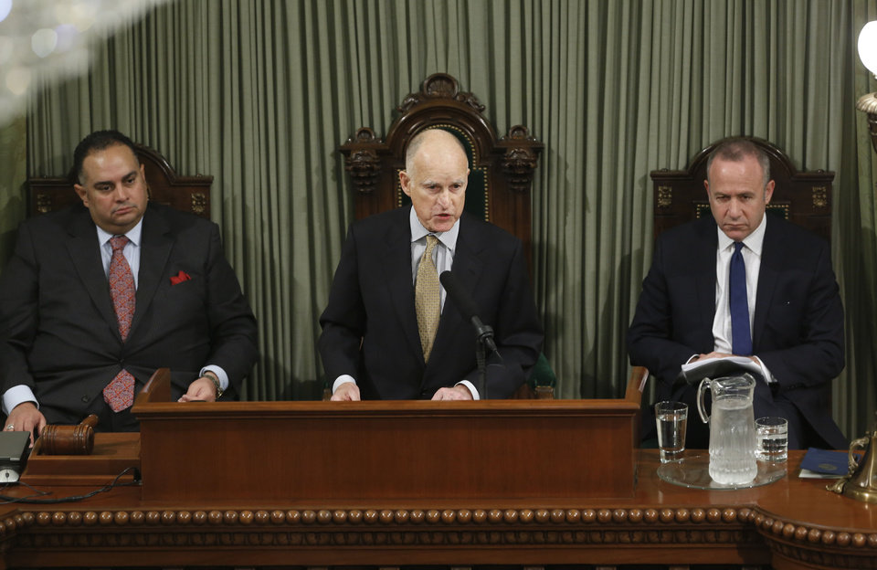 FILE -- In this Jan. 24, 2013 file photo, Gov. Jerry Brown, center, gives his State of the State Address, flanked by Assembly Speaker John Perez, D-Los Angeles, left, and Senate President Pro Tem Darrell Steinberg, D-Sacramento, right, at the Capitol in Sacramento, Calif.    With super majorities in the California Legislature, Democrats have begun to chart an ambitious legislative agenda that includes gun control, revenue increases, voting rights, environmental protections and other proposals that would make significant changes to California law if passed and signed into law by Gov. Jerry Brown.(AP Photo/Rich Pedroncelli,file)