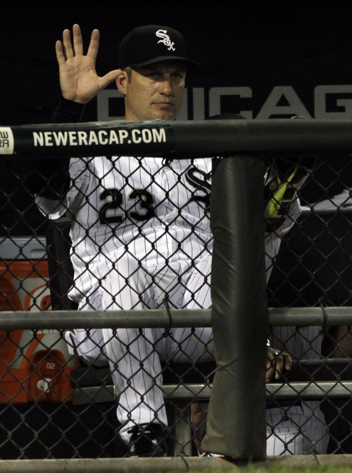 Photo -   Chicago White Sox's manager Robin Ventura gestures toward his batter during the ninth inning of a baseball game against the Minnesota Twins, Tuesday, Sept.4, 2012, in Chicago. The Twins beat the Sox 18-9. (AP Photo/John Smierciak)
