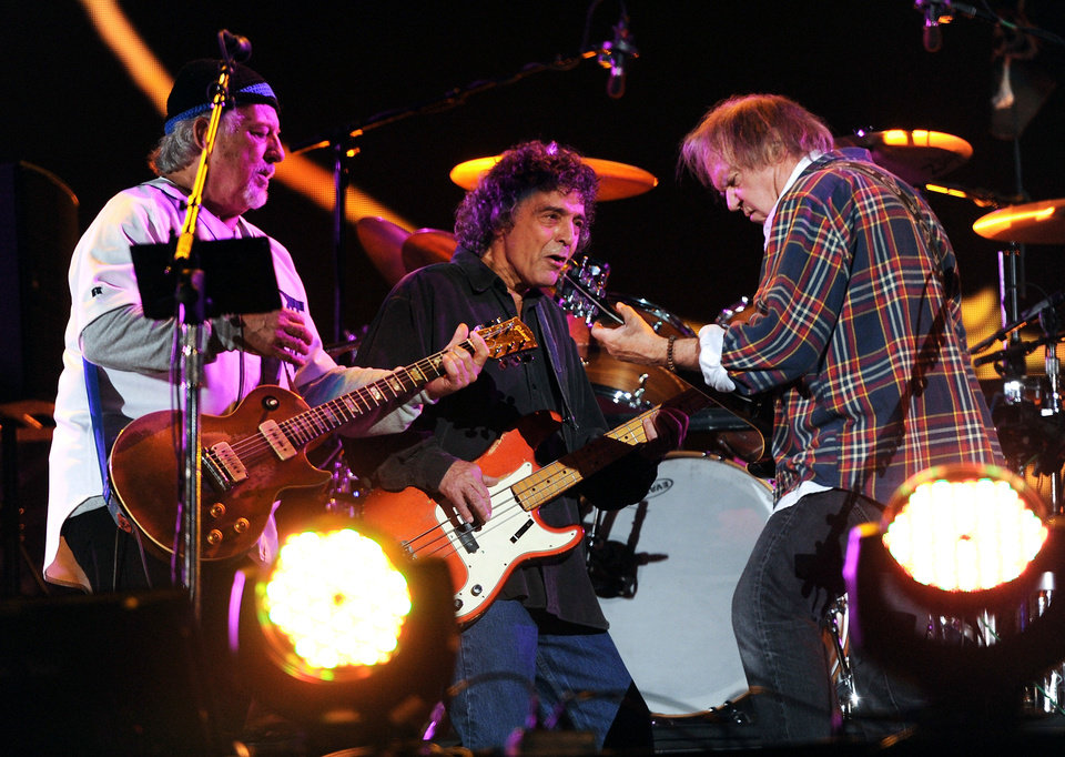 Photo - Neil Young, right, performs with his band Crazy Horse including Frank Sampedro, left, and Ralph Molina, at the Global Citizen Festival in Central Park onSept. 29 in New York. AP PHOTO  Evan Agostini