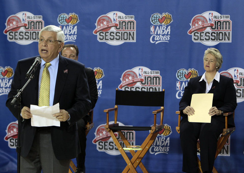 NBA Commissioner David Stern, left, speaks as Houston Mayor Annise Parker listens during an event at the start of the NBA All-Star Jam Session for this weekend's all-star basketball game, in the George R. Brown Convention Center on Thursday, Feb. 14, 2013, in Houston. (AP Photo/Houston Chronicle, James Nielsen) MANDATORY CREDIT