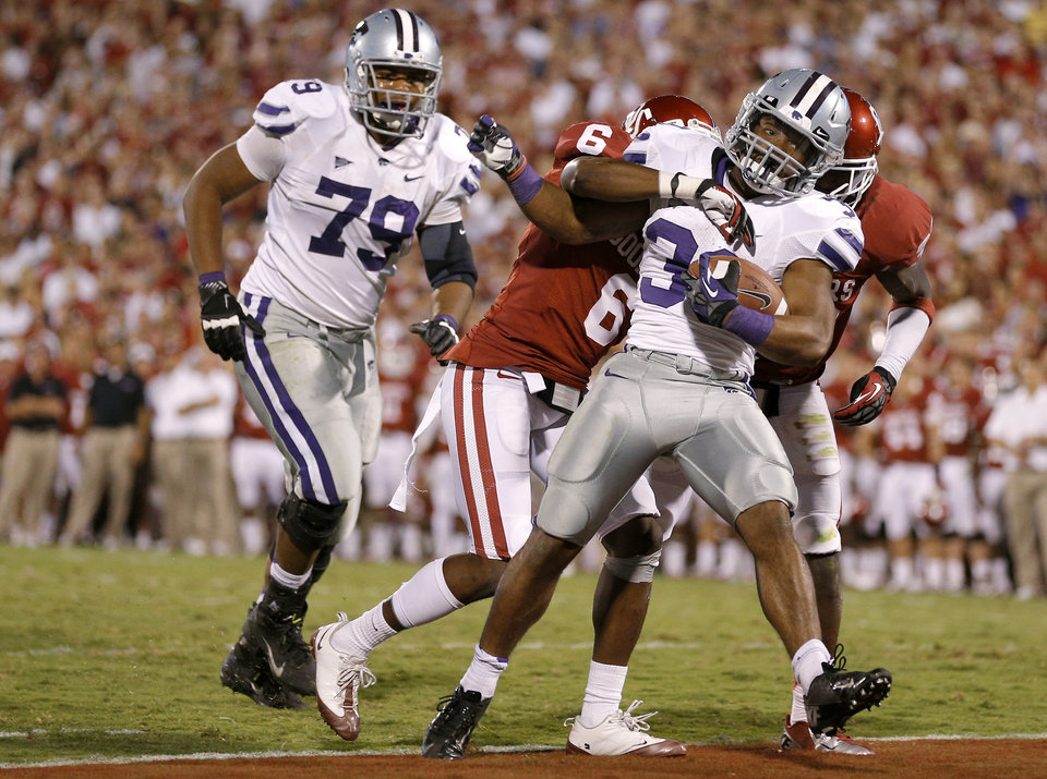 Kansas State\'s John Hubert (33) scores a touchdown in front of Oklahoma\'s Demontre Hurst (6) as Kansas State\'s Keenan Taylor (79) watches during a college football game between the University of Oklahoma Sooners (OU) and the Kansas State University Wildcats (KSU) at Gaylord Family-Oklahoma Memorial Stadium, Saturday, September 22, 2012. Oklahoma lost 24-19. Photo by Bryan Terry, The Oklahoman