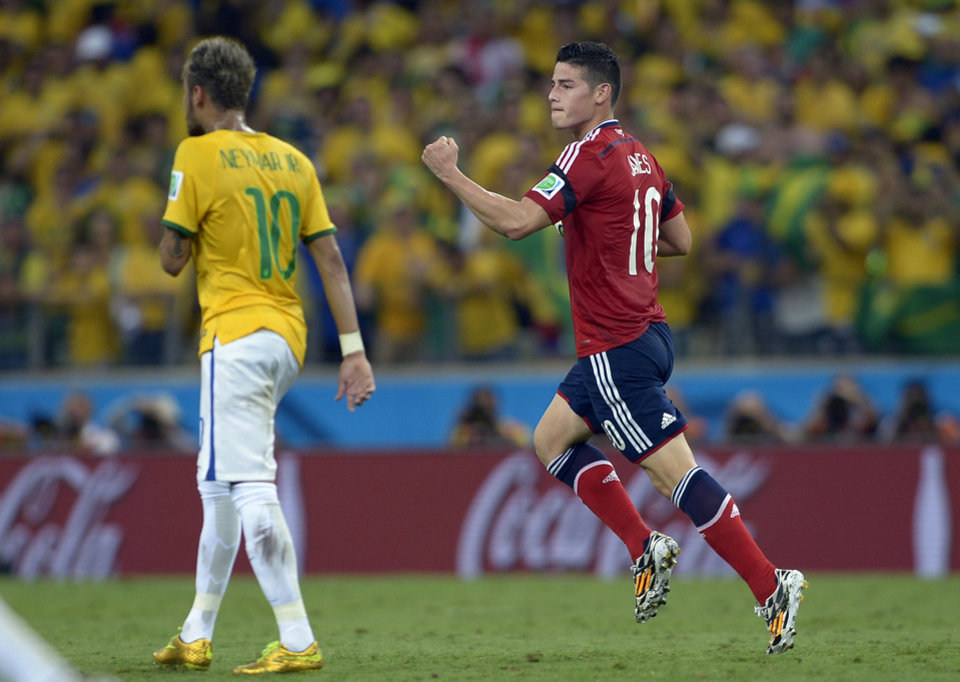 Photo - Colombia's James Rodriguez celebrates after scoring his side's first goal during the World Cup quarterfinal soccer match between Brazil and Colombia at the Arena Castelao in Fortaleza, Brazil, Friday, July 4, 2014. (AP Photo/Manu Fernandez)