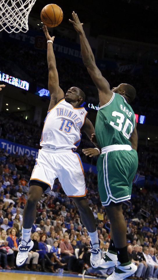 Oklahoma City's Reggie Jackson (15) shoots a lay up as Boston's Brandon Bass (30) defends during the NBA game between the Oklahoma City Thunder and the Boston Celtics at the Chesapeake Energy Arena., Sunday, Jan. 5, 2014. Photo by Sarah Phipps, The Oklahoman