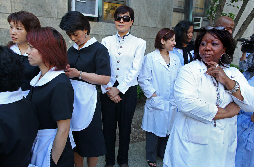 Photo -   Hotel workers from New York hotels who who were bused in by their union gather at the Manhattan Criminal Courts building before the arrival of Dominique Strauss-Kahn for his arraignment proceedings on charges of sexually assaulting a Manhattan hotel maid, Monday, June 6, 2011 in New York (AP Photo/Craig Ruttle)