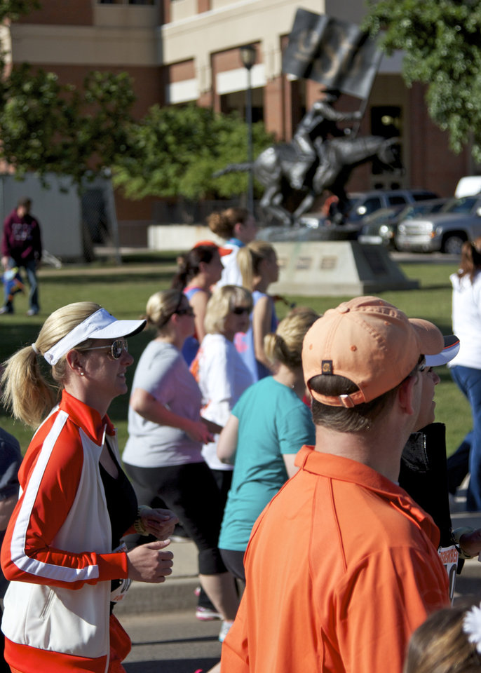 Runners run in front of the Spirit rider during the Remember the Ten run  held in Stillwater, Okla., on April 21, 2012. Photos by Mitchell Alcala for the Oklahoman  ORG XMIT: KOD