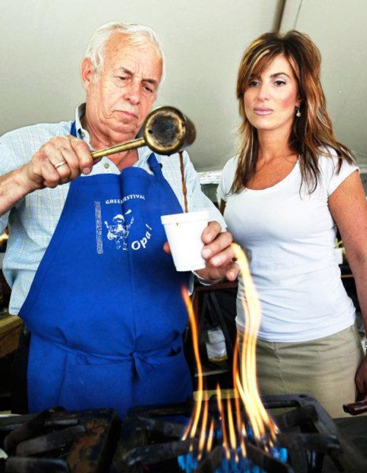 Photo - Gus Gianos pours a freshly made serving of Greek coffee into a cup for his daughter-in-law, Irene Gianos on Friday, Sep. 9, 2011, during the 27th annual Greek Festival at St. George Greek Orthodox Church in far northwest Oklahoma City.  Gianos said Greek coffee is not percolated but each cup of the  beverage is cooked fresh  over a flame and served hot.  He said the sugar is added during the cooking process and he said the taste is stronger than most other coffees.  Gus Gianos has been working at the festival since it began. Photo by Jim Beckel, The Oklahoman  ORG XMIT: KOD