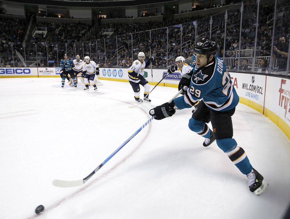 Photo - San Jose Sharks right wing Ryane Clowe (29) passes the puck against Nashville Predators during the first period of an NHL hockey game in San Jose, Calif., Saturday, March 2, 2013. (AP Photo/Tony Avelar)