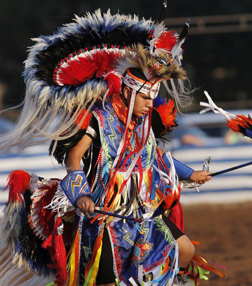 Photo - A Pawnee Nation dancer performs at the Pawnee Bill Wild West Show in Pawnee, Oklahoma on Saturday,  June 23, 2012.  Photo by Jim Beckel, The Oklahoman