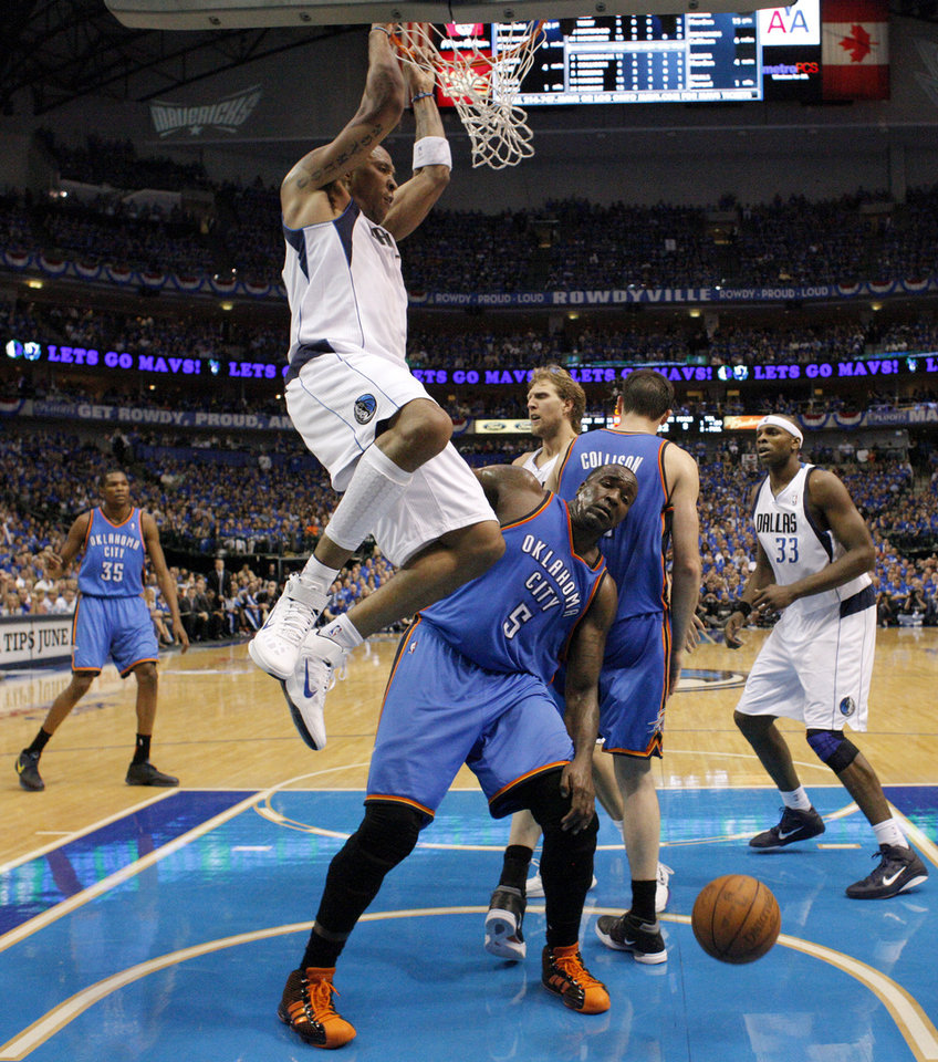 Shawn Marion (0) of Dallas  dunks the ball over Oklahoma City's Kendrick Perkins (5) during game 5 of the Western Conference Finals in the NBA basketball playoffs between the Dallas Mavericks and the Oklahoma City Thunder at American Airlines Center in Dallas, Wednesday, May 25, 2011. Photo by Bryan Terry, The Oklahoman