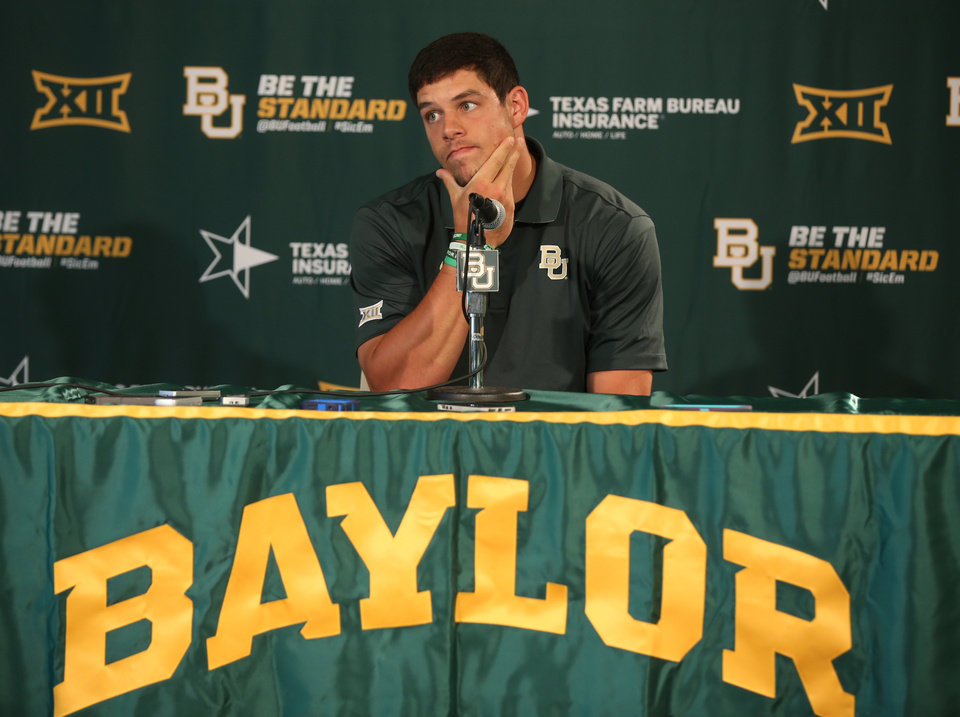 Photo - Baylor senior  starting quarterback Bryce Petty pauses before answering  a question during a press conference, Monday, Aug. 25, 2014, in Waco, Texas. Baylor will face SMU Sunday during their season opener at their new McLane stadium . (AP Photo/Waco Tribune Herald, Rod Aydelotte)
