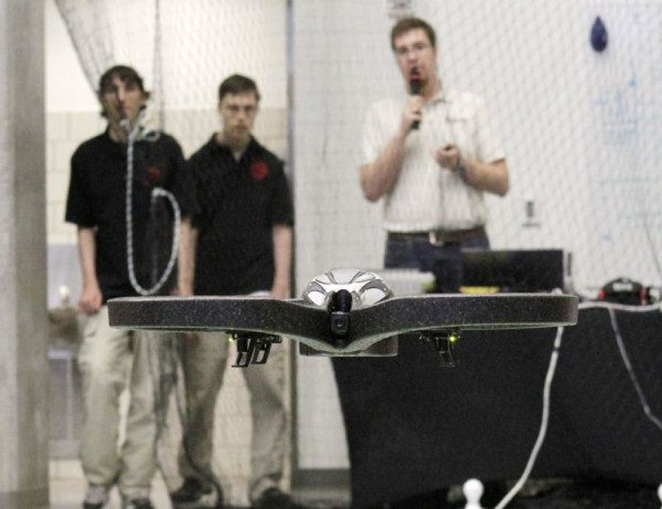 A drone flies toward a target as students from middle and high schools compete with flying drones at the University of Oklahoma's Rawls Engeineering Practice Facility in Norman, OK, Saturday, Dec. 3, 2011. By Paul Hellstern, The Oklahoman ORG XMIT: KOD