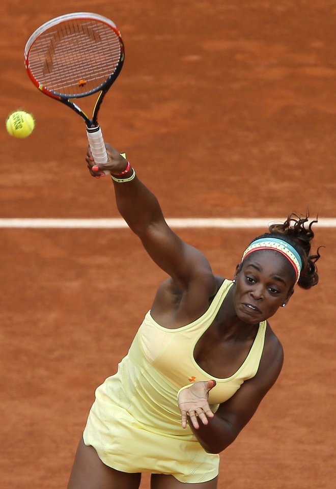 Photo - Sloane Stephens of the U.S, smashes the ball to Romania's Simona Halep during their fourth round match of  the French Open tennis tournament at the Roland Garros stadium, in Paris, France, Monday, June 2, 2014. (AP Photo/Michel Spingler)