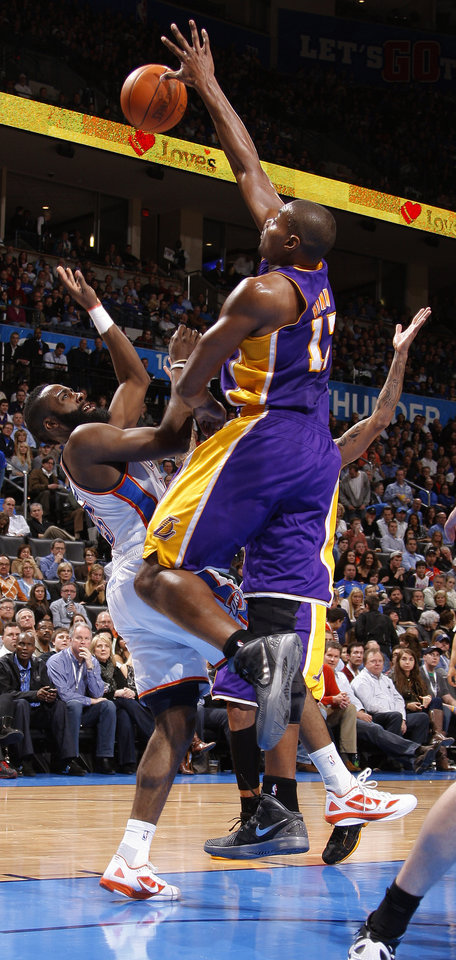 Los Angeles\' Andrew Bynum (17) blocks the shot of Oklahoma City\'s James Harden (13) during an NBA basketball game between the Oklahoma City Thunder and the Los Angeles Lakers at Chesapeake Energy Arena in Oklahoma City, Thursday, Feb. 23, 2012. Photo by Bryan Terry, The Oklahoman