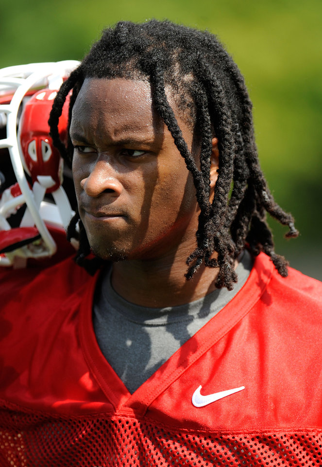 Photo - Georgia running back Todd Gurley takes a break from drills during the first day of fall practice for the NCAA college football practice, Friday, Aug. 1, 2014, in Athens, Ga. (AP Photo/Athens Banner-Herald, Richard Hamm)