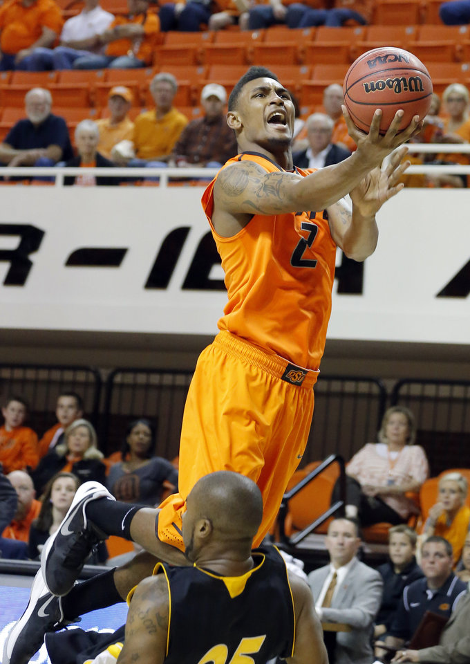 Oklahoma State\'s Kirby Gardner shoots over Ottawa\'s Julian Rose during the college basketball game between Oklahoma State University and Ottawa (Kan.) at Gallagher-Iba Arena in Stillwater, Okla., Thursday, Nov. 1, 2012. Photo by Sarah Phipps, The Oklahoman