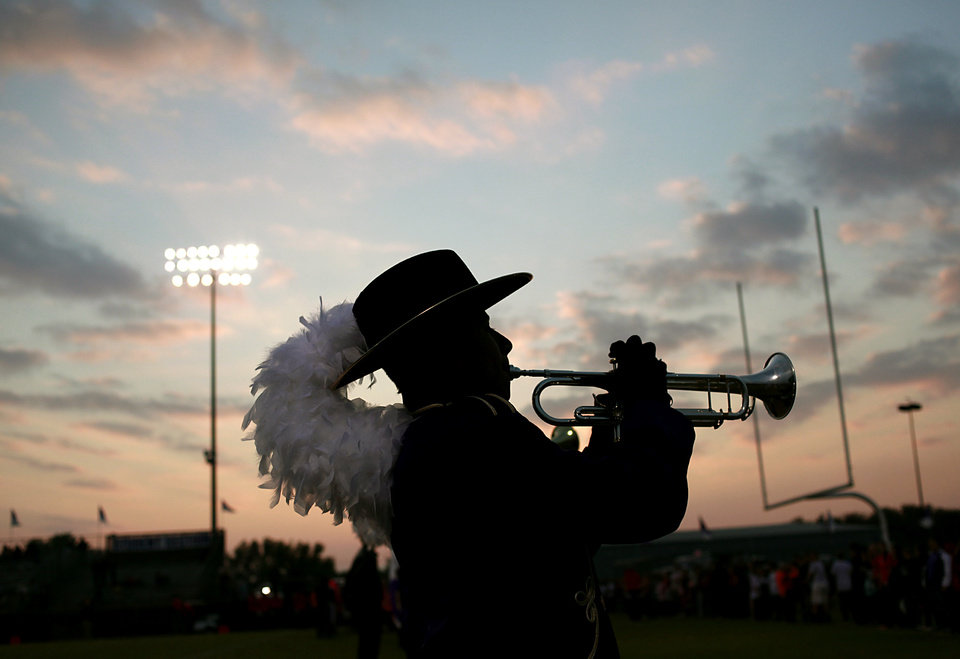 Photo - The sun sets behind Bethany high school freshman David Noriega as he plays with the high school band before Bethany and Washington played their high school football game in Bethany, Okla., on Friday, September 16, 2011. Photo by John Clanton, The Oklahoman