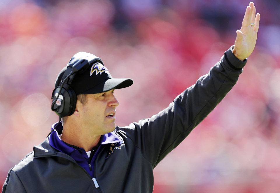 Baltimore Ravens coach John Harbaugh gestures during the first half of an NFL football game against the Kansas City Chiefs at Arrowhead Stadium in Kansas City, Mo., Sunday, Oct. 7, 2012. (AP Photo/Ed Zurga)