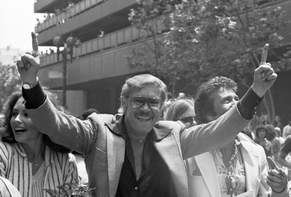 Photo - FILE - In this May 19, 1980 file photo, Los Angeles Lakers owner Jerry Buss gestures as the NBA championship team is honored with a parade in Los Angeles. Buss, the Lakers' playboy owner who shepherded the NBA franchise to 10 championships, has died. He was 79. Bob Steiner, an assistant to Buss, confirmed Monday, Feb. 18, 2013  that Buss had died in Los Angeles. Further details were not available. (AP Photo/File)