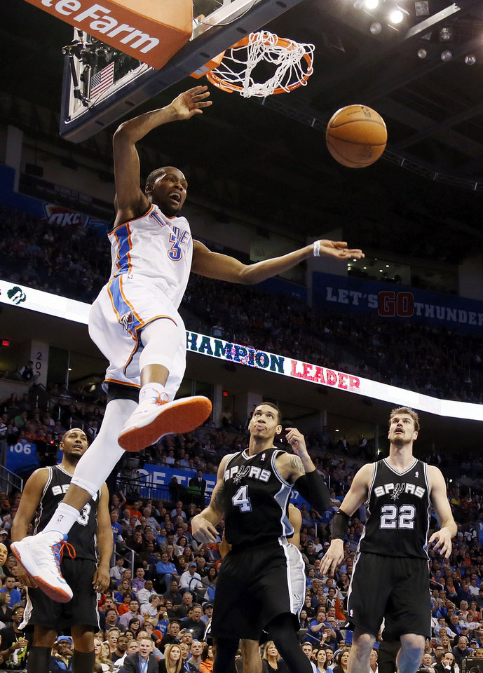 ALTERNATE CROP: Oklahoma City\'s Kevin Durant (35) dunks the ball in front of San Antonio\'s Boris Diaw (33), Danny Green (4) and Tiago Splitter (22) during an NBA basketball game between the Oklahoma City Thunder and the San Antonio Spurs at Chesapeake Energy Arena in Oklahoma City, Thursday, April 4, 2013. The Thunder won 100-88. Photo by Nate Billings, The Oklahoman