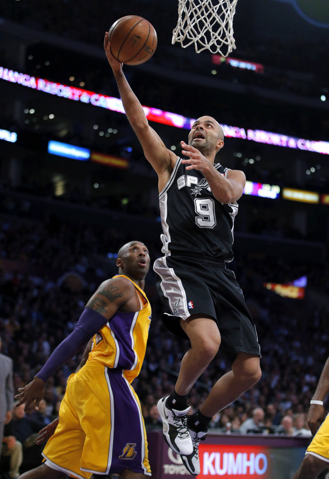 Photo -   San Antonio Spurs' Tony Parker, of France, goes up for a basket as Los Angeles Lakers' Kobe Bryant, left, watches in the first half of an NBA basketball game in Los Angeles, Tuesday, Nov. 13, 2012. (AP Photo/Jae C. Hong)