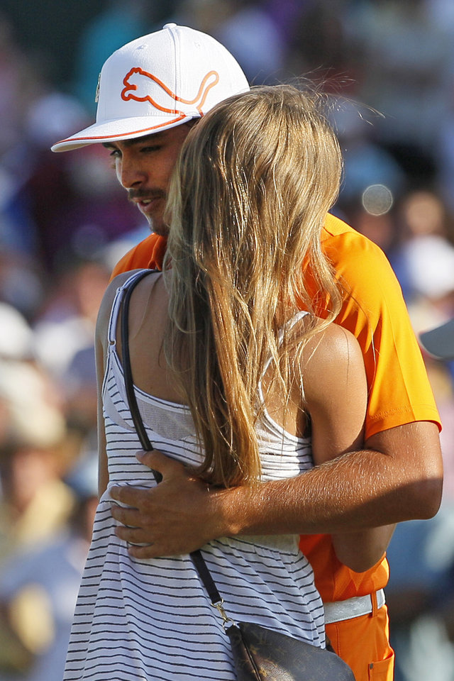 Photo -   Rickie Fowler, rear, hugs his girlfriend Alexandra Browne, front, after winning the Wells Fargo Championship golf tournament on the first playoff hole at Quail Hollow Club in Charlotte, N.C., Sunday, May 6, 2012. (AP Photo/Gerry Broome)