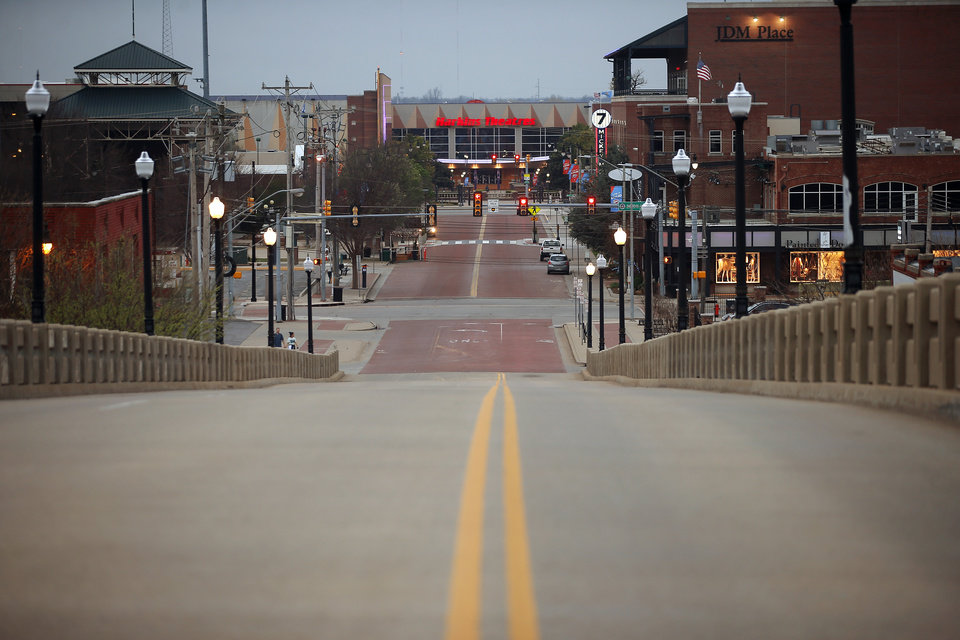 Photo - Empty streets along the Dr. G. E. Finely bridge on N. Walnut looking south towards  Bricktown in Oklahoma City, Friday, March 27, 2020. [Bryan Terry/The Oklahoman]