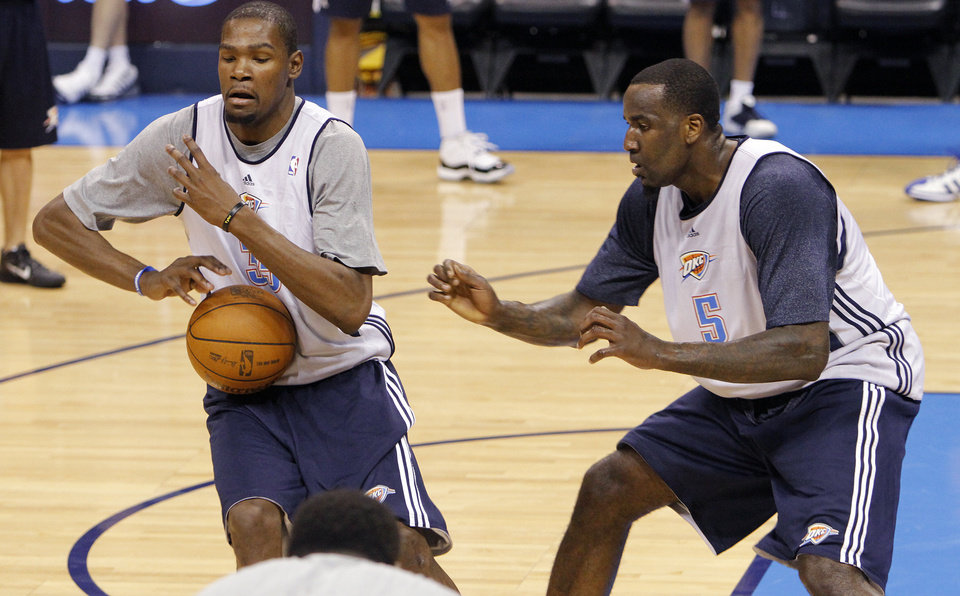 Photo - Oklahoma City's Kevin Durant and Kendrick Perkins go through drills during the NBA Finals practice day at the Chesapeake Energy Arena on Monday, June 11, 2012, in Oklahoma City, Okla. Photo by Chris Landsberger, The Oklahoman