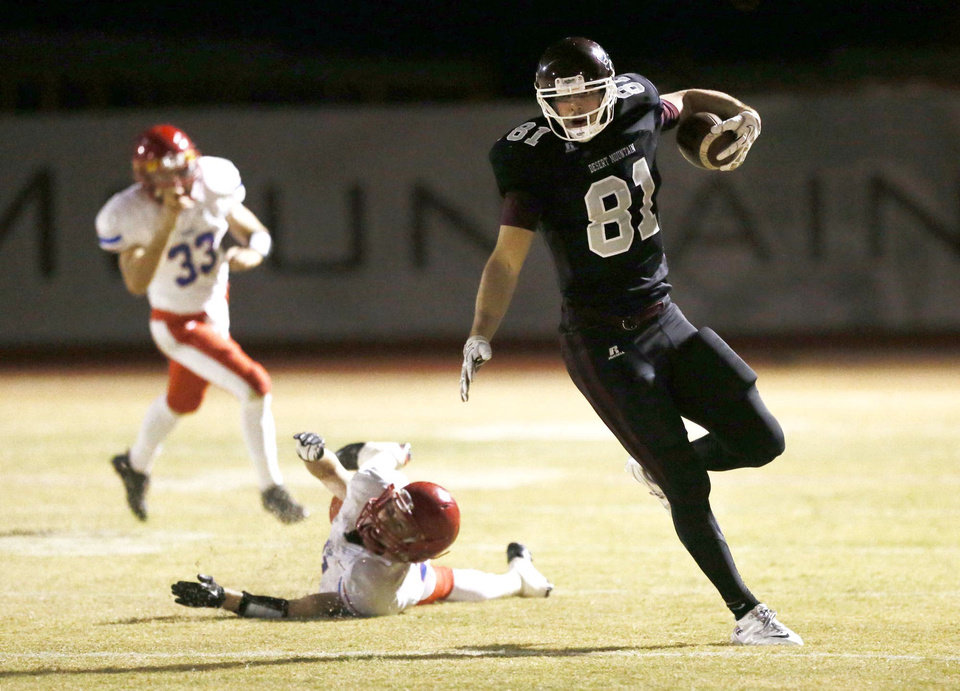 Scottsdale Desert Mountain wide receiver #81 Mark Andrews runs for a first down after breaking a tackle by Mesa Mountain View's Connor Ipsen played at Desert Mountain High School in Scottsdale, AZ. PHOTO COURTESY ARIZONA REPUBLIC <strong>Rob Schumacher</strong>
