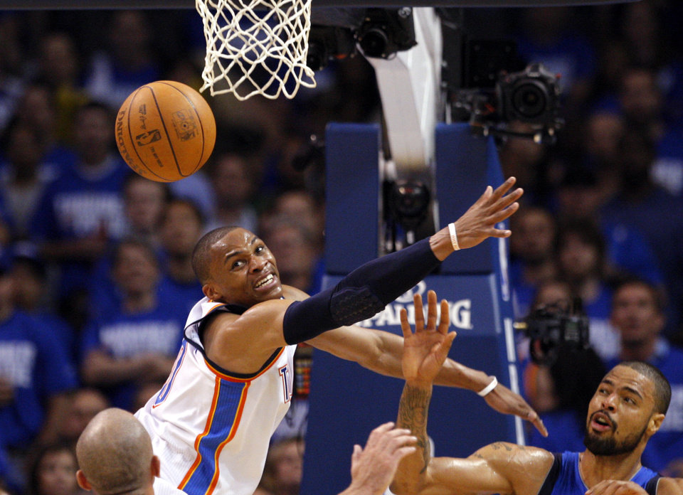 Oklahoma City's Russell Westbrook (0) tries to grab a rebound during game 3 of the Western Conference Finals of the NBA basketball playoffs between the Dallas Mavericks and the Oklahoma City Thunder at the OKC Arena in downtown Oklahoma City, Saturday, May 21, 2011. Photo by Sarah Phipps, The Oklahoman
