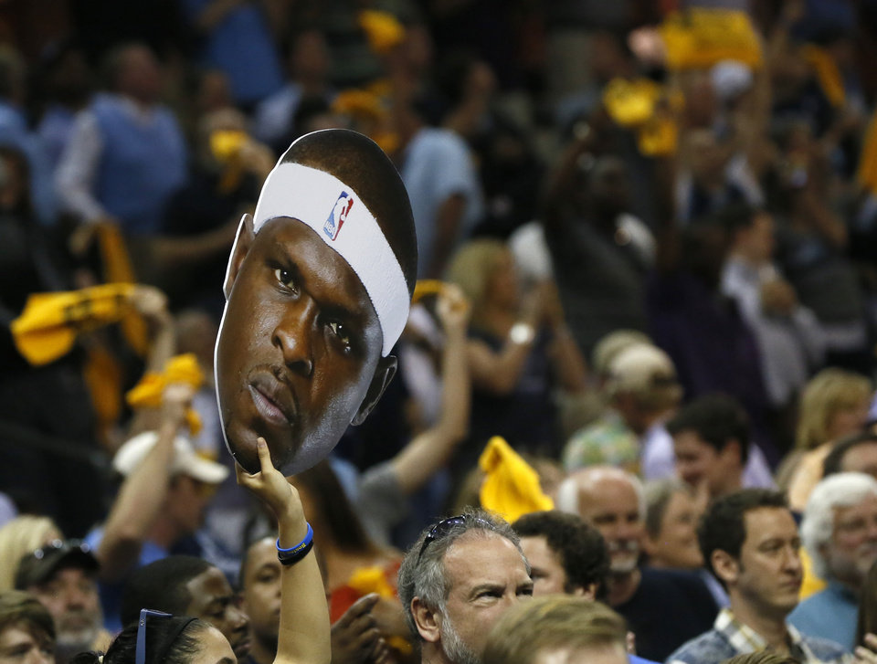 Photo - A fan holds a cutout of the head of  Memphis' Zach Randolph (50) during Game 3 in the second round of the NBA basketball playoffs between the Oklahoma City Thunder and Memphis Grizzles at the FedExForum in Memphis, Tenn., Saturday, May 11, 2013. Photo by Nate Billings, The Oklahoman