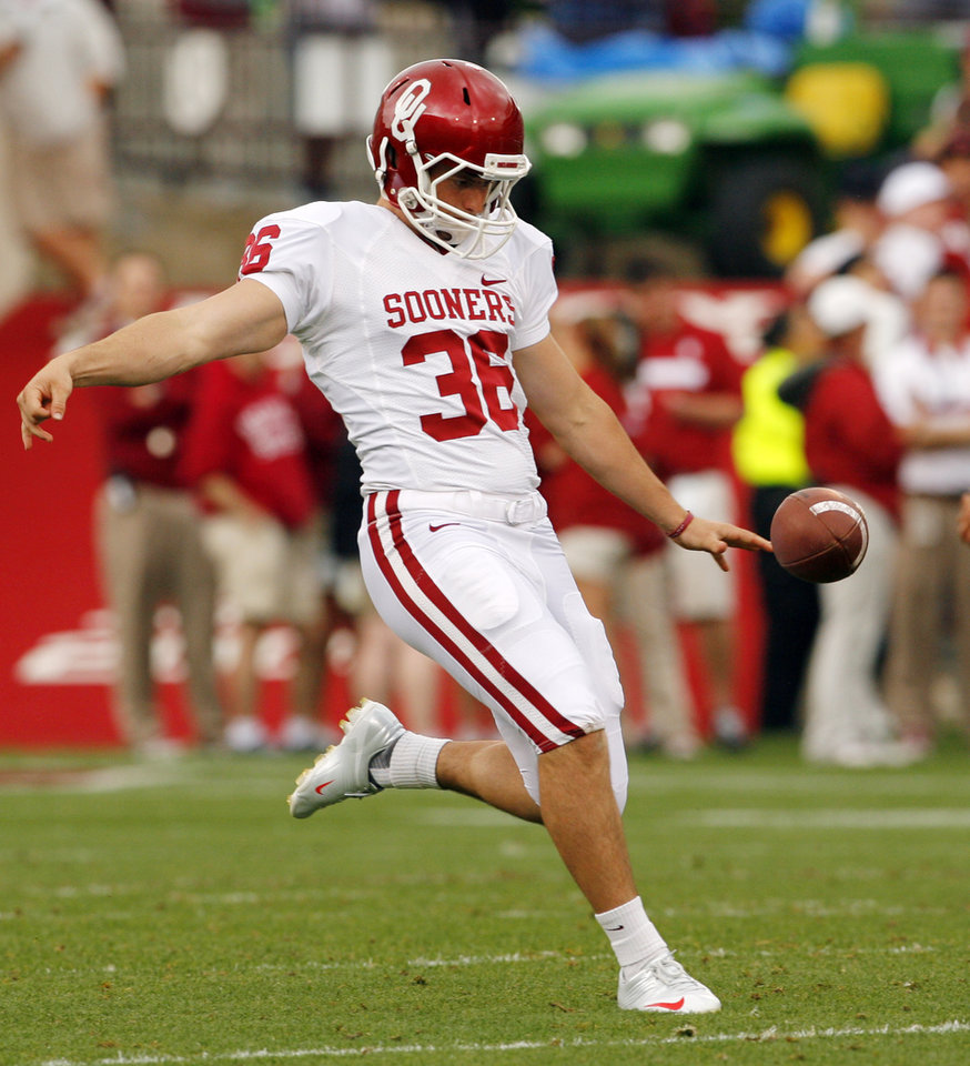 Tress Way punts during the University of Oklahoma (OU) football team's annual Red and White Game at Gaylord Family/Oklahoma Memorial Stadium on Saturday, April 14, 2012, in Norman, Okla.  Photo by Steve Sisney, The Oklahoman